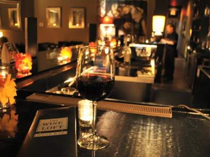 glass of red wine at the wine loft charlotte