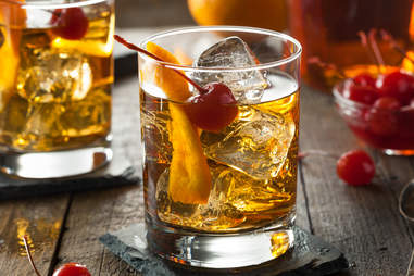 Old-fashioned with cherry set on wood table