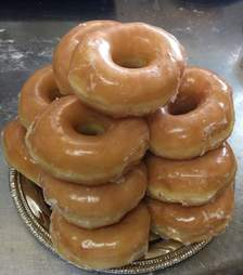 Glazed donuts stacked in multiple columns