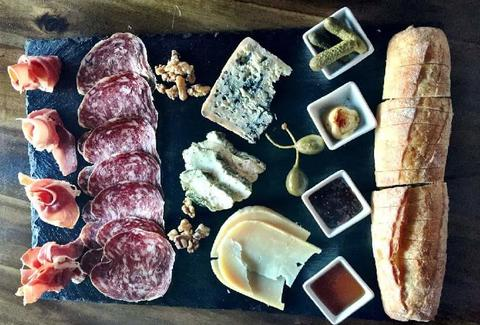 close up of cheese and charcuterie board at ardoa wine bar charleston