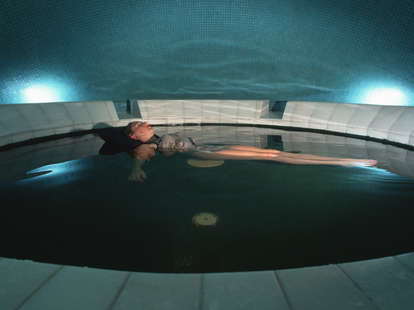 Woman floating in sensory deprivation pool