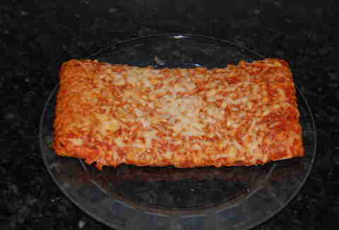 A slice of frozen Ellio's pizza on a plate