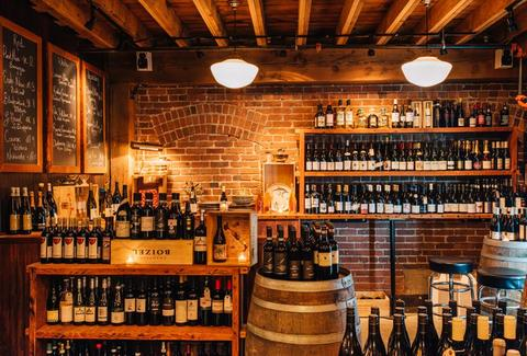 interior of lower bar ferdinand seattle brick walls barrels bottles of wine
