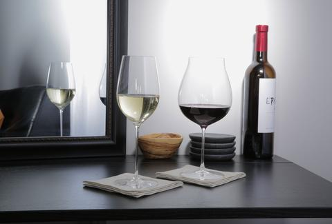 white wine and red wine glasses and bottle