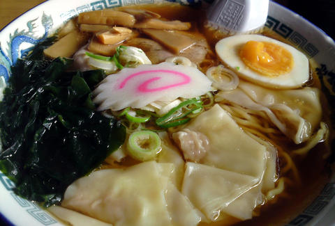 bowl of ramen soup with noodles and soft egg