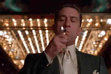 Robert DeNiro lighting a cigarette in Martin Scorsese's Casino