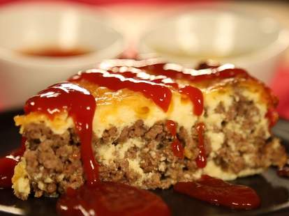 piece of cheeseburger frittata with hot sauce thrillist recipes