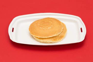 McDonald's hot cakes on white paper platter