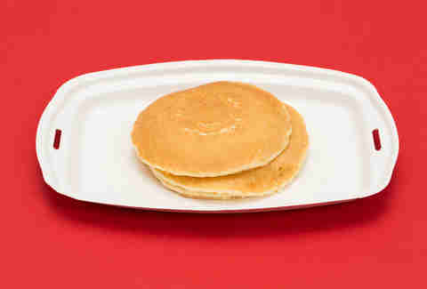 McDonald's hot cakes on white paper platter