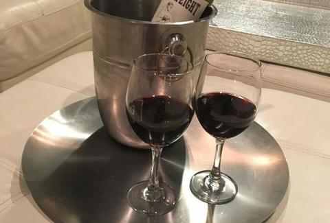 two glasses of wine red bottle service shiraz indianapolis