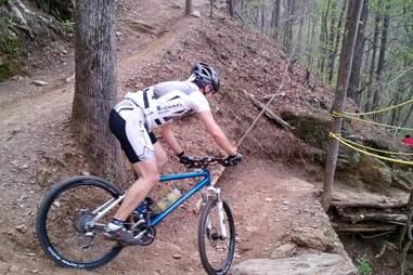 Man road biking down Blankets Creek trail