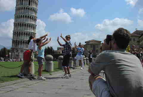 Leaning Tower of Pisa in Italy pose
