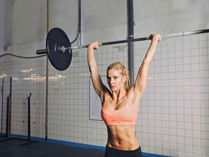 Female lifting heavy weight