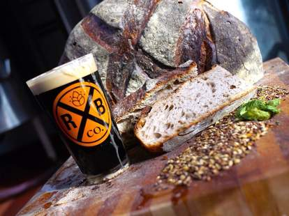 Pint glass of Rockaway brewing beer with miche bread