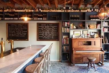 interior of Augustine wine bar, piano