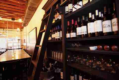 wines lined on a shelf at Vintage Enoteca