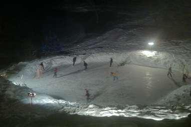 Friends skiing in frozen Minnesota pond