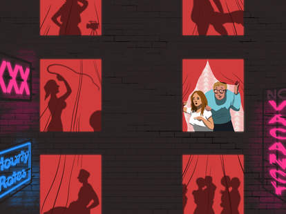 Windows of sex hotel, where silhouettes of couples are having sex