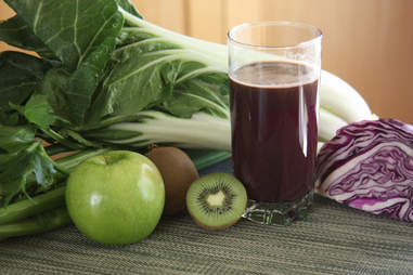 juicing with kiwi, apples and vegetables