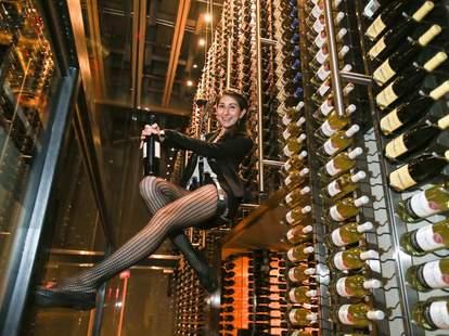 girl serving wine bottles at CIBO