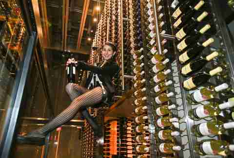 girl serving wine bottles at CIBO