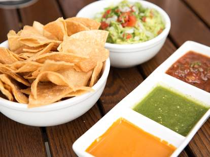 Salsa and guacamole dip with tortilla chips