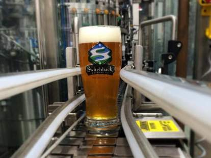 beer on factory line at switchback brewing in vermont craft beer