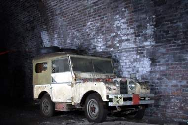 Land rover car in bad condition against brick wal