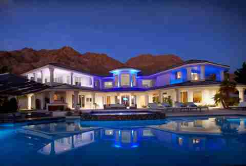 airbnb las vegas pool mansion night lit up