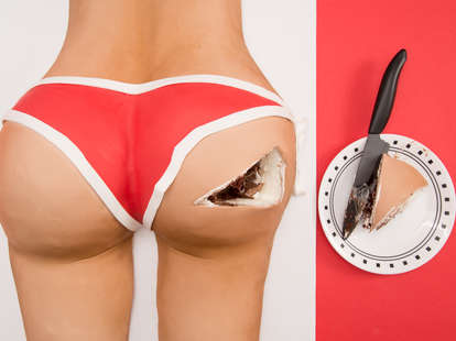 Cake in the shape of a butt with a slice taken out