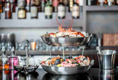 seafood tower sitting on bar at Annex