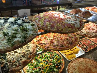 pizzas on display at previti pizza in manhattan new york city nyc