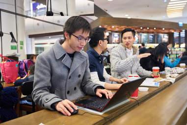 Man working on his laptop at Starbucks