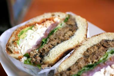 cemita sandwich cut in half with taco meat