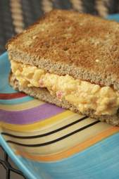 Pimento cheese sandwich on striped plate