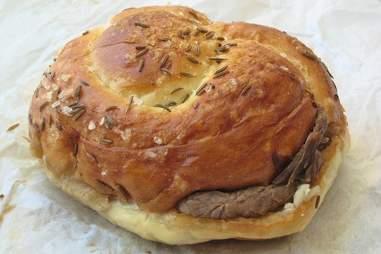 beef on weck sandwich on wax paper