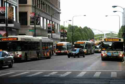 Buses arriving at the same time in Chicago hood