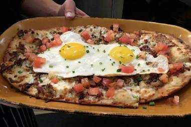 eggs on a flatbread with tomatoes