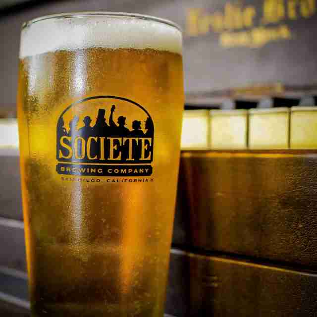 Full glass of Societe pale ale beer