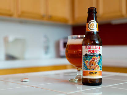Ballast Point Brewing Company with full glass on kitchen island