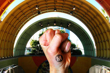 metro los angeles station, with a fist raised