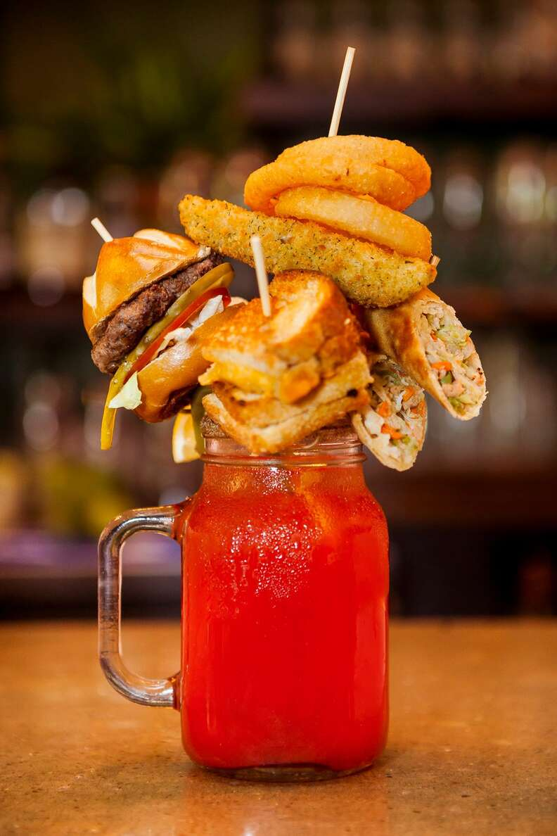 bloody caesar with burger, onion rings and grilled cheese