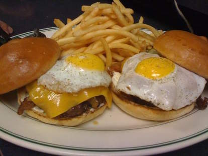 two burgers with cheese fried eggs and french fries the old fashioned madison