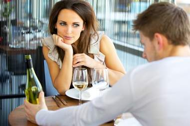 couple on date with wine