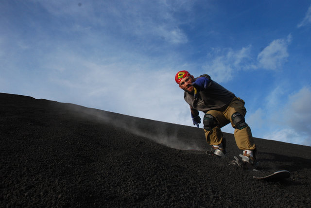 Man volcano surfing down a volcano in Nicaragua