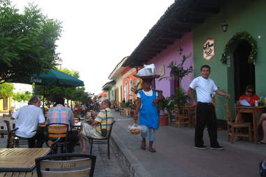 Residents carrying groceries in Granada, Nicaragua