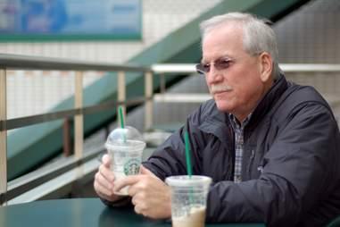elderly man at Starbucks