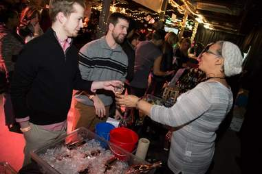 Visitors of Sip Savor Stomp receiving glasses of wine