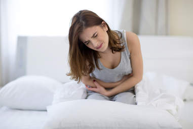 woman sick with stomach ache