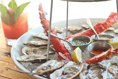 raw oysters and crab legs at Greenwich Project